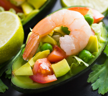 Salad with avocado, fresh  vegetables and shrimps