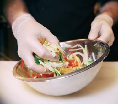 Chef is cooking a vegetarian salad at professional kitchen, toned